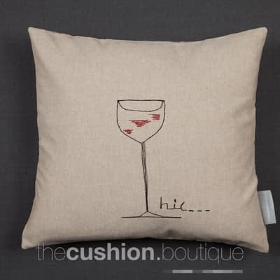Handmade linen cushion featuring single wine glass in free machine embroidery