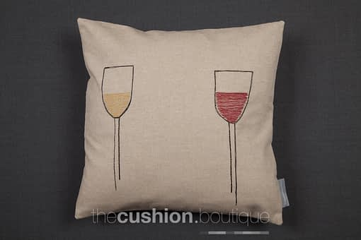 Handmade cushion featuring free machine embroidered red & white wine glasses