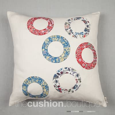 Liberty print appliquéd rings on white Linen